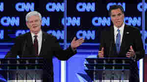 Republican presidential hopefuls former House Speaker Newt Gingrich and former Massachusetts Gov. Mitt Romney debate in Jacksonville, Fla., on Thursday.