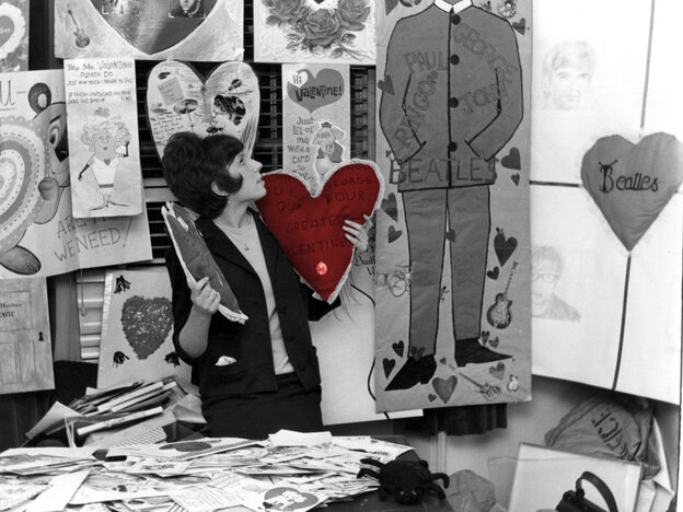 The secretary of the Beatles fan club, surrounded by hundreds of Valentine's cards sent to the group by adoring fans.