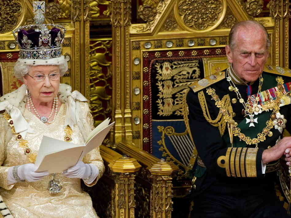 Britain's Prince Philip listens as his wife, Queen Elizabeth II,  addresses the House of Lords during the Opening of Parliament in London on May 25, 2010, a few weeks after the British general election. American elections can have an alluring appeal to Europeans because of their excitement.