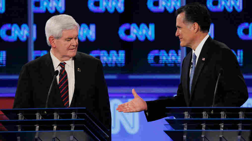 Mitt Romney offers a handshake to GOP rival Newt Gingrich after a Jan. 26 debate in Jacksonville, Fla., the last debate before the Florida primary.