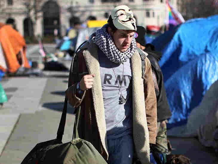 A demonstrator removes his belongings following a deadline to leave the Occupy D.C. encampment at Freedom Plaza on Jan. 30, 2012 in Washington, D.C. The Occupy Wall Street movement has been fighting for months to address the issue of income inequality.