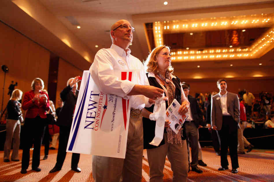 Gingrich supporters in Orlando listen as Mitt Romney is declared the winner of the Florida primary.