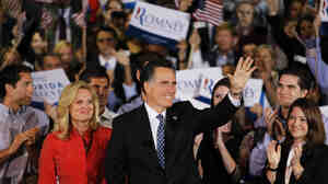 Republican presidential candidate Mitt Romney waves to supporters after winning the Florida primary