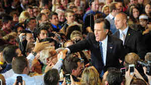 Mitt Romney greets supporters during a victory party Tuesday night in Tampa, Fla.