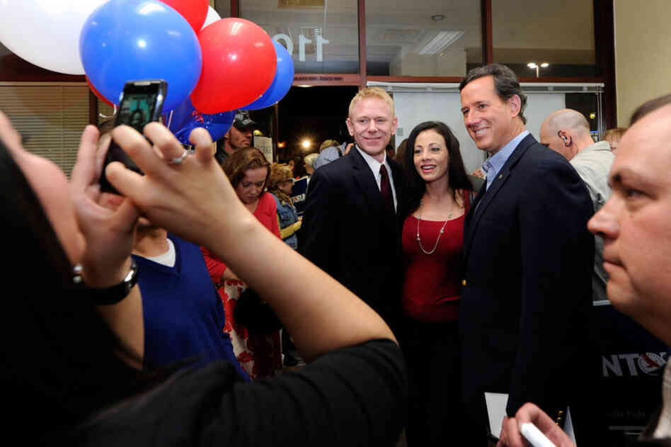 "Rick Santorum poses for photos with supporters at an election results party for the Florida primary at his Nevada campaign headquarters in Las Vegas. His basic message last night was that ""Republicans can do better."""