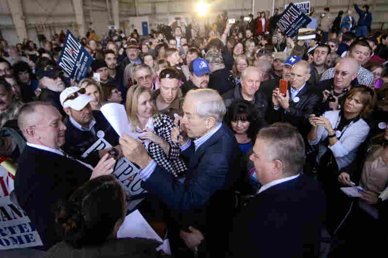 "Ron Paul signs autographs at a campaign rally in Colorado Springs. ""We want our freedoms back, we don't want more government!"" Paul said as he wrapped up his speech in Henderson, Nev., where he was campaigning Tuesday."