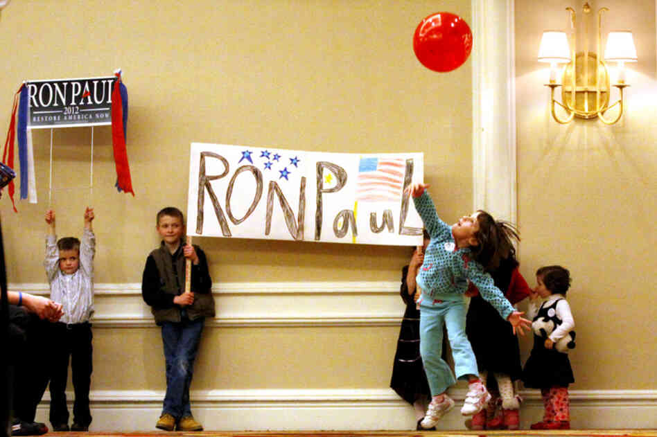 Young Ron Paul supporters wait for Paul to arrive for a town hall meeting in Denver.
