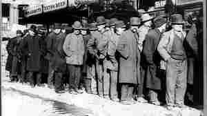 """A bread line forms outside of the Rescue Society in New York City in 1929. """"Brother, Can You Spare a Dime?"""" directly confronted the hardship of the Great Depression."""