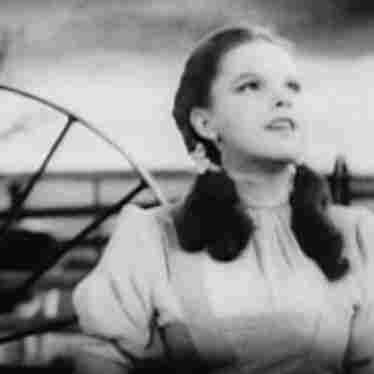 Actress and singer Judy Garland wearing as Dorothy from director Victor Fleming's film, The Wizard of Oz.
