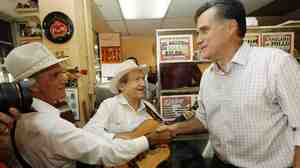 Mitt Romney campaigns at Casa Marin restaurant in Hialeah, Fla., on Sunday.