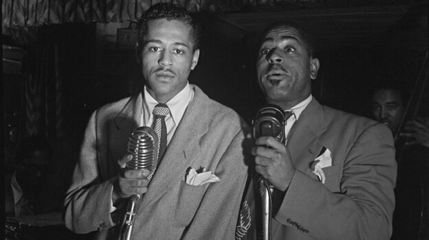 Dizzy Gillespie (right) with Kenny Hagood (left).