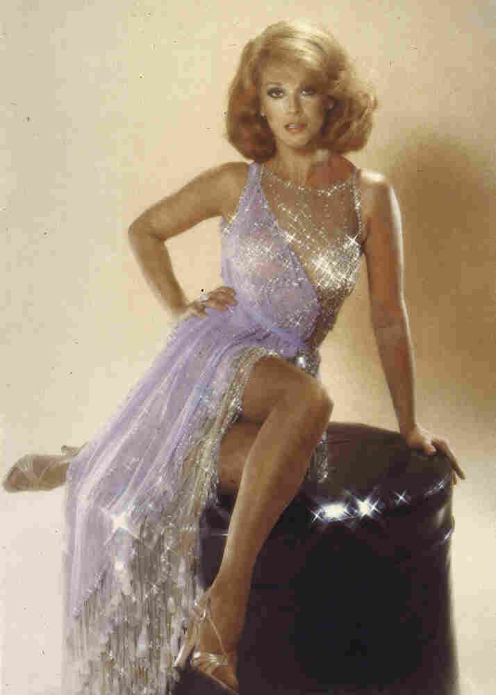 Actress Ann-Margret wearing a sparkly silver, low-cut gown by Bob Mackie.
