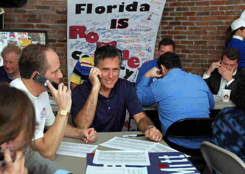 Mitt Romney works the phones for votes at his campaign headquarters in Tampa.