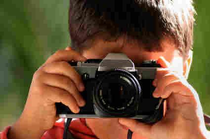 A boy takes a photo.