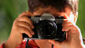 A boy takes a photo.
