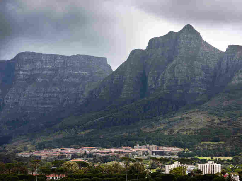 The University of Cape Town (UCT) shown nestled under Devil's Peak and Table Mountain in Cape Town, South Africa. UCT is one of many options for students looking for a good value in their education.