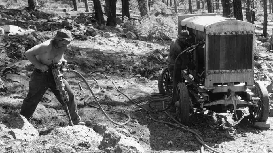 Controlling dust from activities like this was on the minds of those in the Department of Labor in the 1930s, as silicosis, a lung disease, was taking a toll on American workers. Above, a worker jackhammers into rock in Lassen National Forest in California in 1934, preparing to shoot explosives.