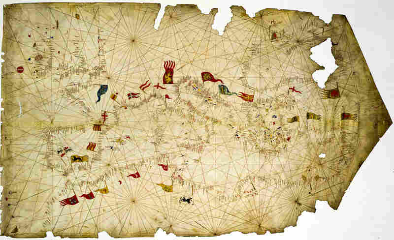 """This 1421 """"Nautical Map"""" by Francesco de Cesanis explores Florentine banking abroad and notes the severe risks involved in traveling. The threats of theft and piracy forced travelers to rely on banks, which provided them with letters of credit in order to avoid having to travel with heavy metal coins."""