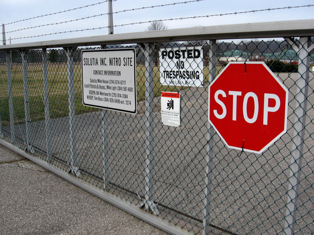 A gate into the former Monsanto chemical plant near Nitro, W.Va. A class-action lawsuit filed against Monsanto (and subsequent company Solutia) claims the company improperly polluted the town with dioxin.