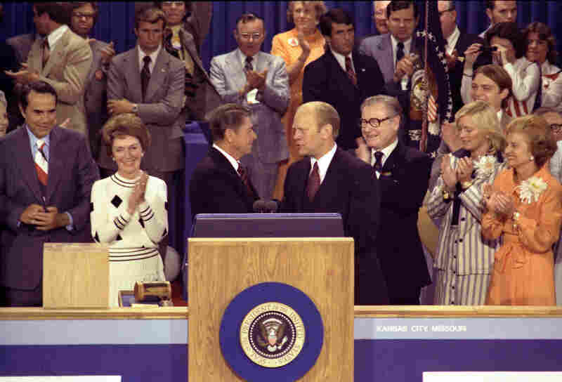 Then-Gov. Ronald Reagan was severely critical of incumbent President Ford when he challenged him for the Republican nomination.  Ford, right center, thanks Reagan, left center, for his remarks on the closing night of the Republican National Convention, Aug. 19, 1976.