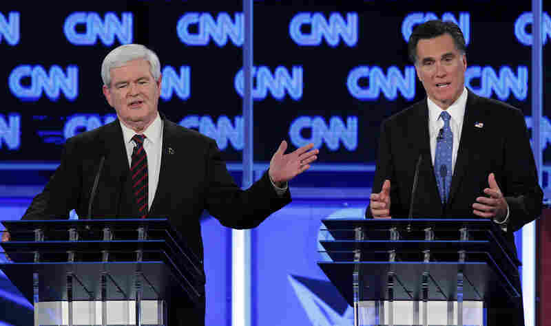In Florida, Mitt Romney approves a TV ad accusing Newt Gingrich of influence peddling. Gingrich, meanwhile, runs an ad mashing Romney.