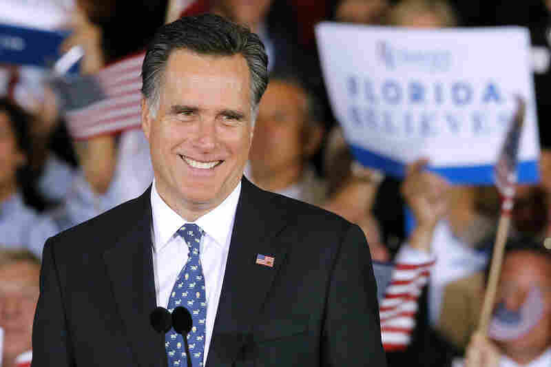 "Mitt Romney smiles at supporters at his primary victory rally in Tampa on Tuesday. ""While we celebrate this victory, we must not forget what this election is really about: defeating Barack Obama,"" the Romney campaign said via Twitter."
