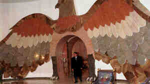 Taken during a 1997 tour of one of Saddam Hussein's palaces, this photo shows a giant falcon made from Italian marble.