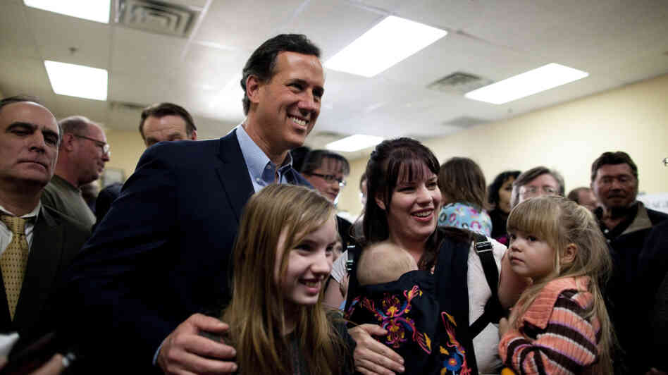 Rick Santorum poses for photos with supporters in Las Vegas on Tuesday night.