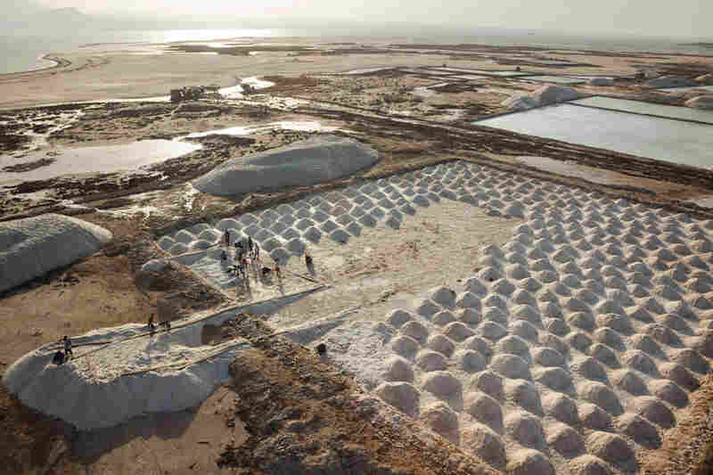 Workers at Lake Afrera process raw salt. Production was temporarily halted last year when a volcano in neighboring Eritrea erupted, blanketing the salt in ash.