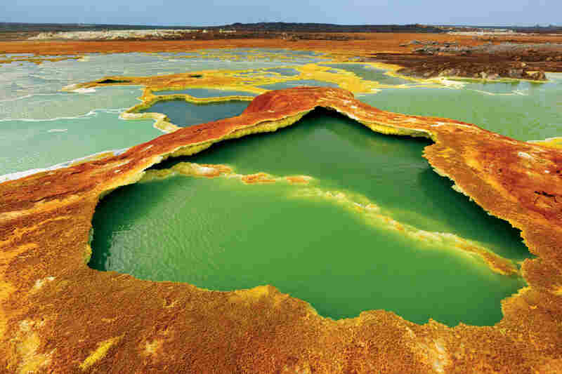 Sulfur and algae turn hot springs into pools of living color. The water is condensation from hot gases rising from magma chambers. As the water evaporates, salts and minerals form a vivid crust.