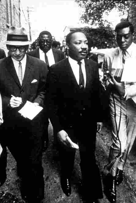 Cornelius (right) interviews civil rights leader Martin Luther King Jr. (center).