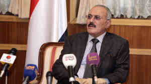 Outgoing Yemeni President Ali Abdullah Saleh speaks to the press at the presidential palace in Sanaa on Jan. 22.