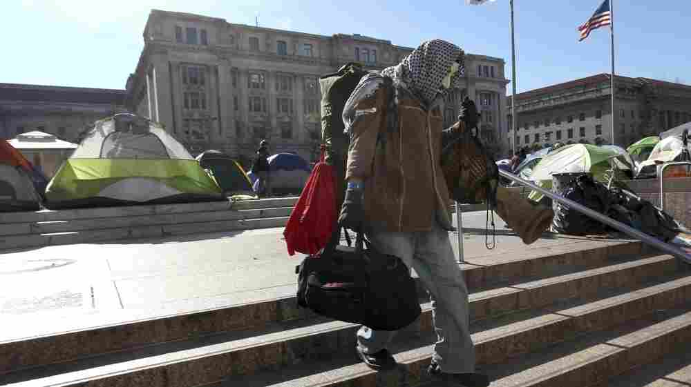 A protester at the Occupy D.C. encampment in Freedom Plaza packed up his belongings Monday ahead of a National Park Service deadline to clear out.