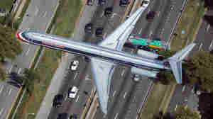 An American Airlines plane flies over a highway in Queens, New York City on Sept. 13, 2009.