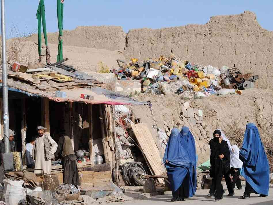 Burqa-clad women walk in the old part of Ghazni on Jan. 15, 2012. Ghazni is one of Afghanistans major cities with the estimated population of 141.000 people and is east of Kabul. Ghazni province has seen significant turmoil over the past few years.