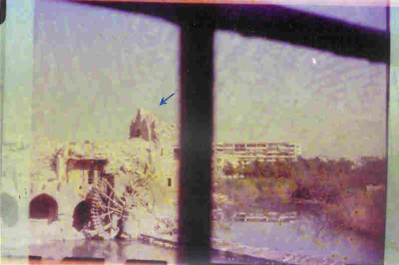 Hama is known for its Roman-era water wheels; in this one, a drawn arrow points to a structure that was badly damaged.