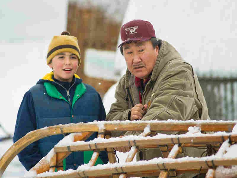 Malik (John Pingayak, right), and his grandson Nathan (Ahmaogak Sweeney) each have a stake in the fate of the whales.