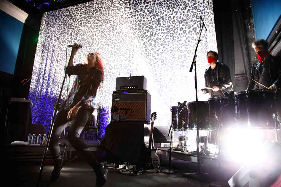 Alison Mosshart and Jamie Hince began their set with a blast of light, leopard print, and the title track to their second album No Wow.