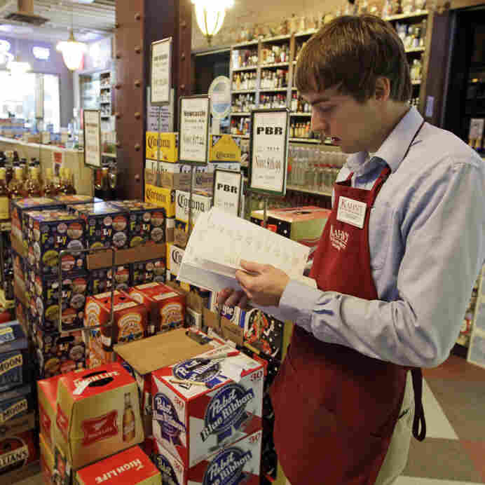 Indiana laws bar all carryout alcohol sales on Sundays, leaving Super Bowl revelers in the lurch in their quest for any 11th-hour 12-pack the day of the big game. At Kahn's Fine Wines and Spirits in Indianapolis  earlier this week, Bill Cheek was putting labels on cases of beer.