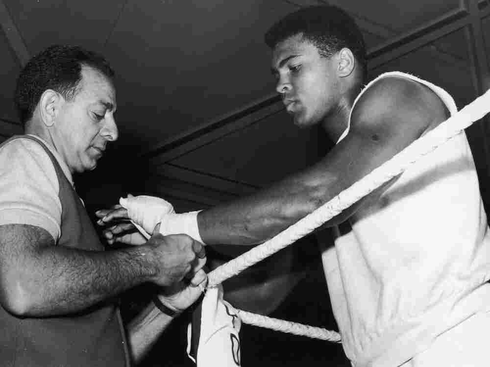 Angelo Dundee and boxer Cassius Clay (later Muhammad Ali), during a training session in 1966.