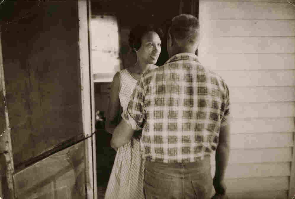 Mildred Loving greets her husband, Richard, on their front porch, 1965.