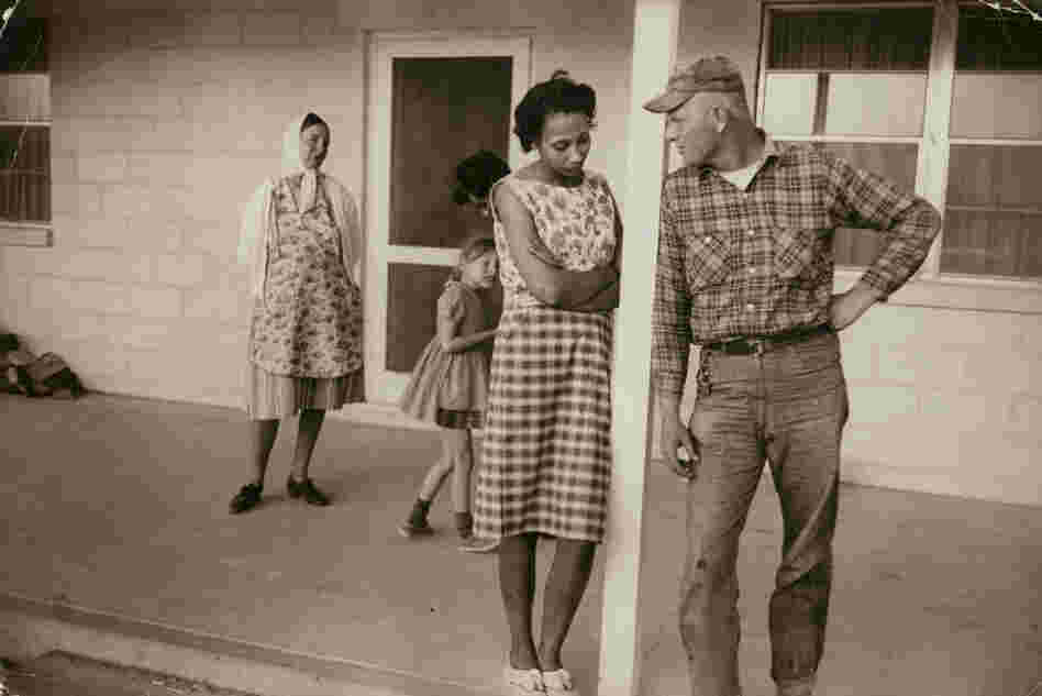 Mildred and Richard Loving; their daughter, Peggy; Mildred's sister Garnet; and Richard's mother, Lola, on the front porch of Mildred's mother's house, Caroline County, Va., April 1965.