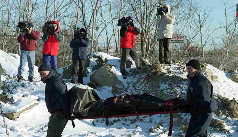 The body of informant John McIntyre being recovered in 2000.  Whitey Bulger is alleged to have killed McIntyre in 1984 after being tipped off that McIntyre was informing on him.