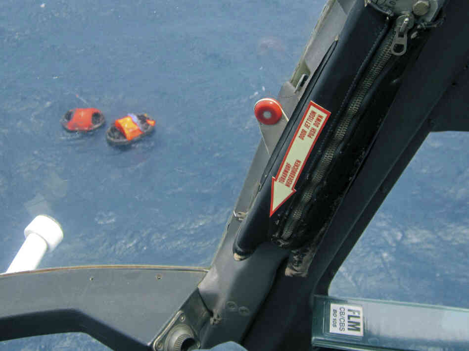 Two life rafts from the MV Rabaul Queen, seen from a helicopter, float in the open waters off Papua New Guinea's east coast, earlier today (Feb. 2, 2012).