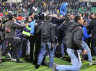 Fans rushed on to the field Wednesday after the soccer match in Port Said, Egypt.