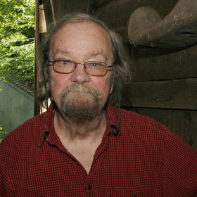 Donald Hall stands in the barn of the 200-year-old Wilmot farm that has been in his family for four generations. His latest poetry collection is called The Back Chamber.