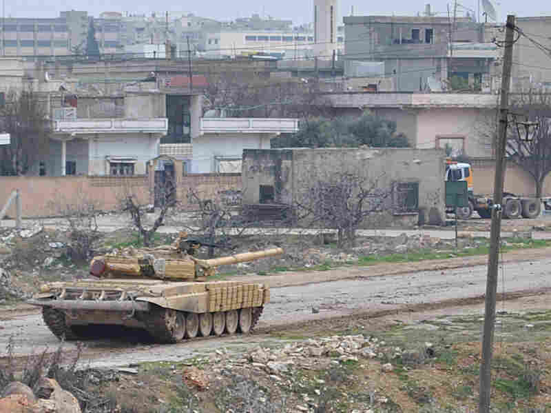 A Syrian army tank moving along a road during clashes with the Syrian army defectors, in the Rastan area in Homs province, central Syria, on Jan. 30.
