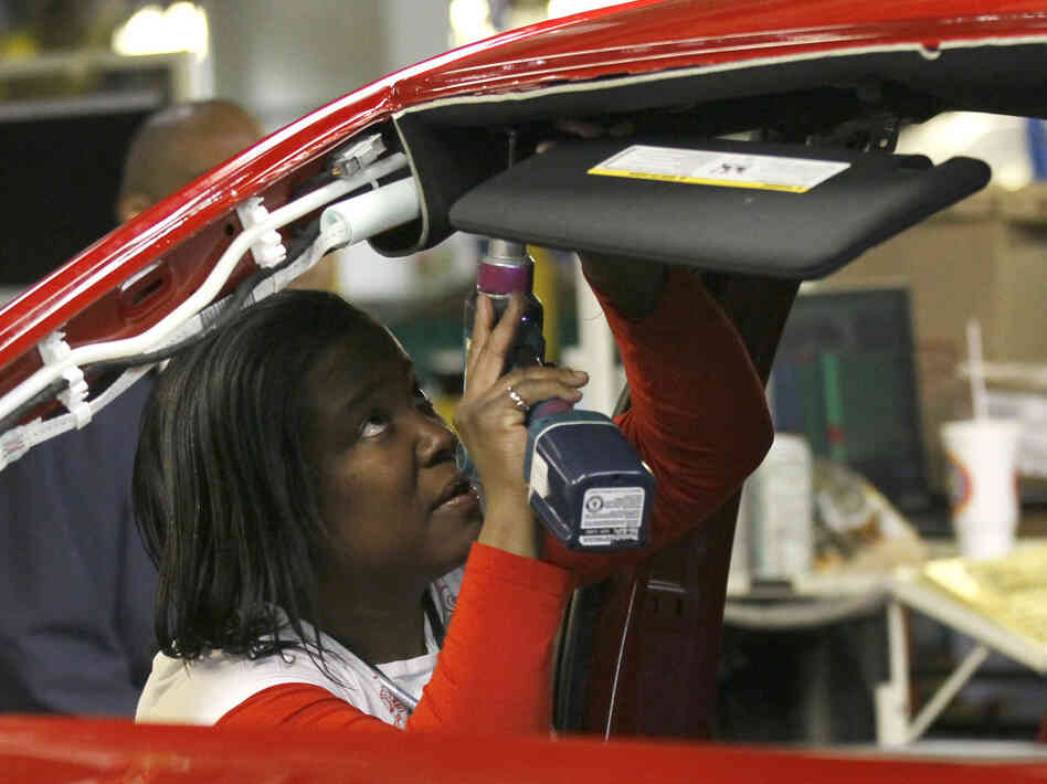 A Chrysler auto worker at the Belvidere, Ill. plant, Thursday, Feb. 2, 2012, where a third shift will be added.