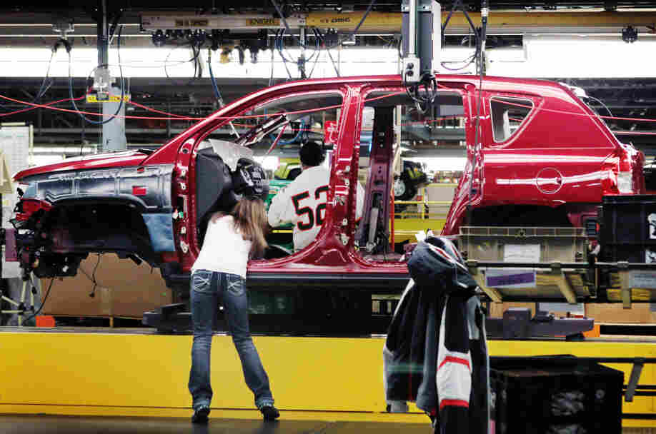 Workers build a Jeep Compass at the Chrysler assembly plant in Belvidere, Ill. Friday's employment report showed growth in manufacturing, much of which reflects the rebirth of the U.S. auto industry .