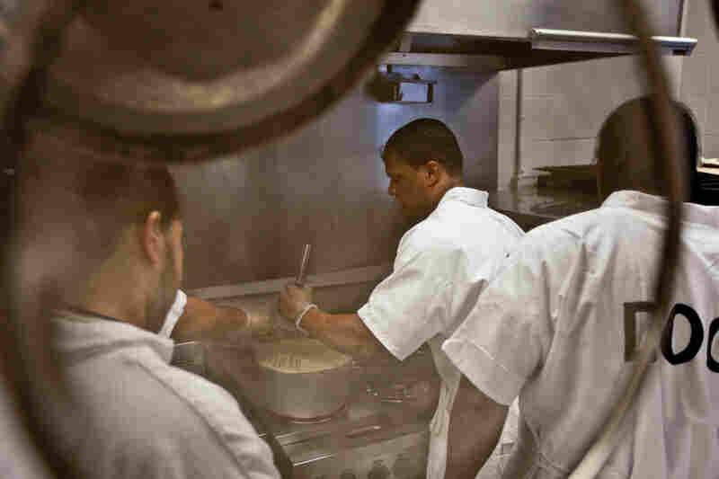 Inmate Calvin Hodge, in the second week of a five-week rotation as head chef, stirs gravy in preparation for lunch at the Fife and Drum Restaurant at the Northeastern Correctional Center in Concord, Mass., Jan. 26.